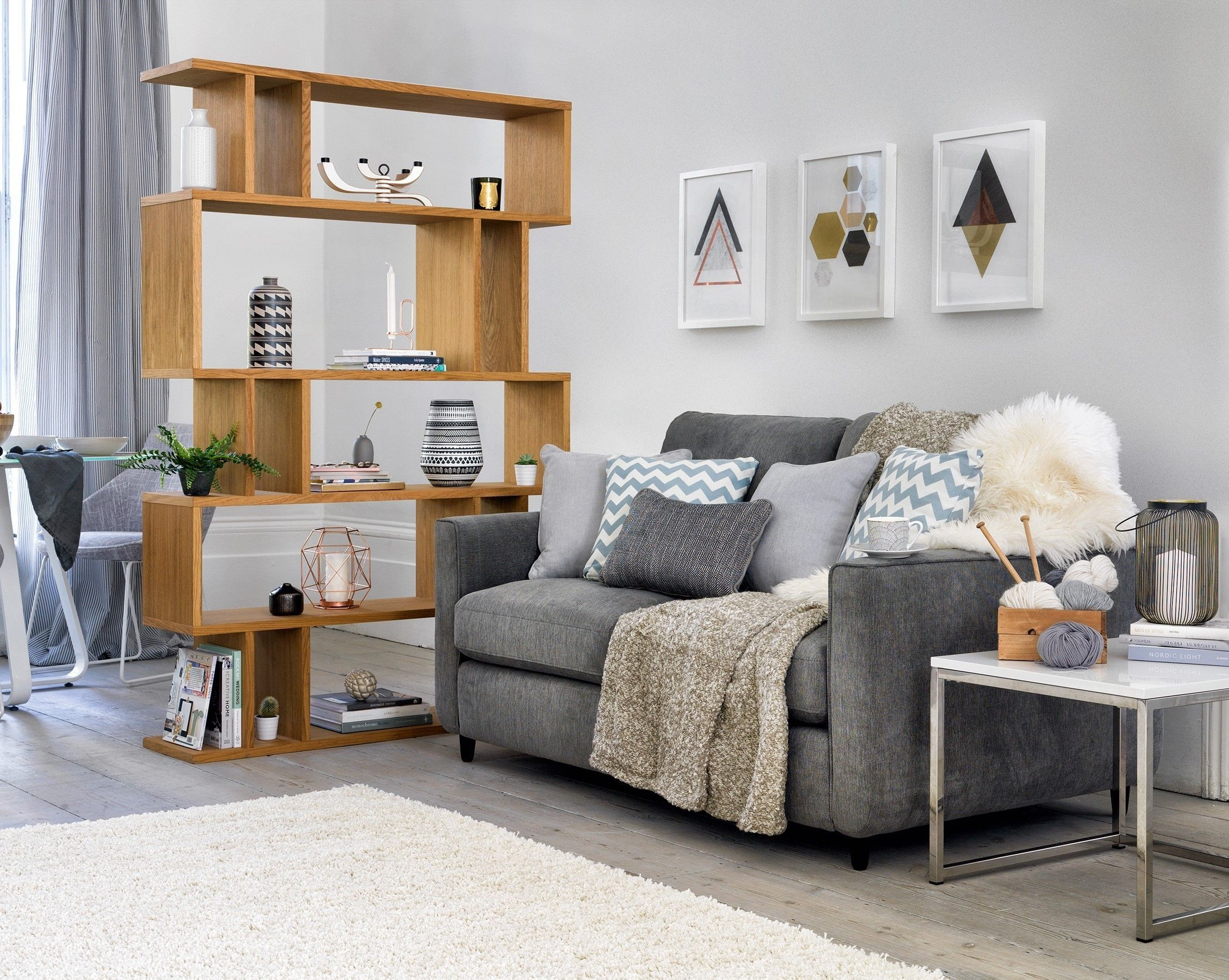 Esprit Two Seater Fabric Sofa, £549 - currently reduced online to £499; Content By Conran Elmari Tall Shelving Unit, £739 - currently reduced online to £449, Furniture Village.