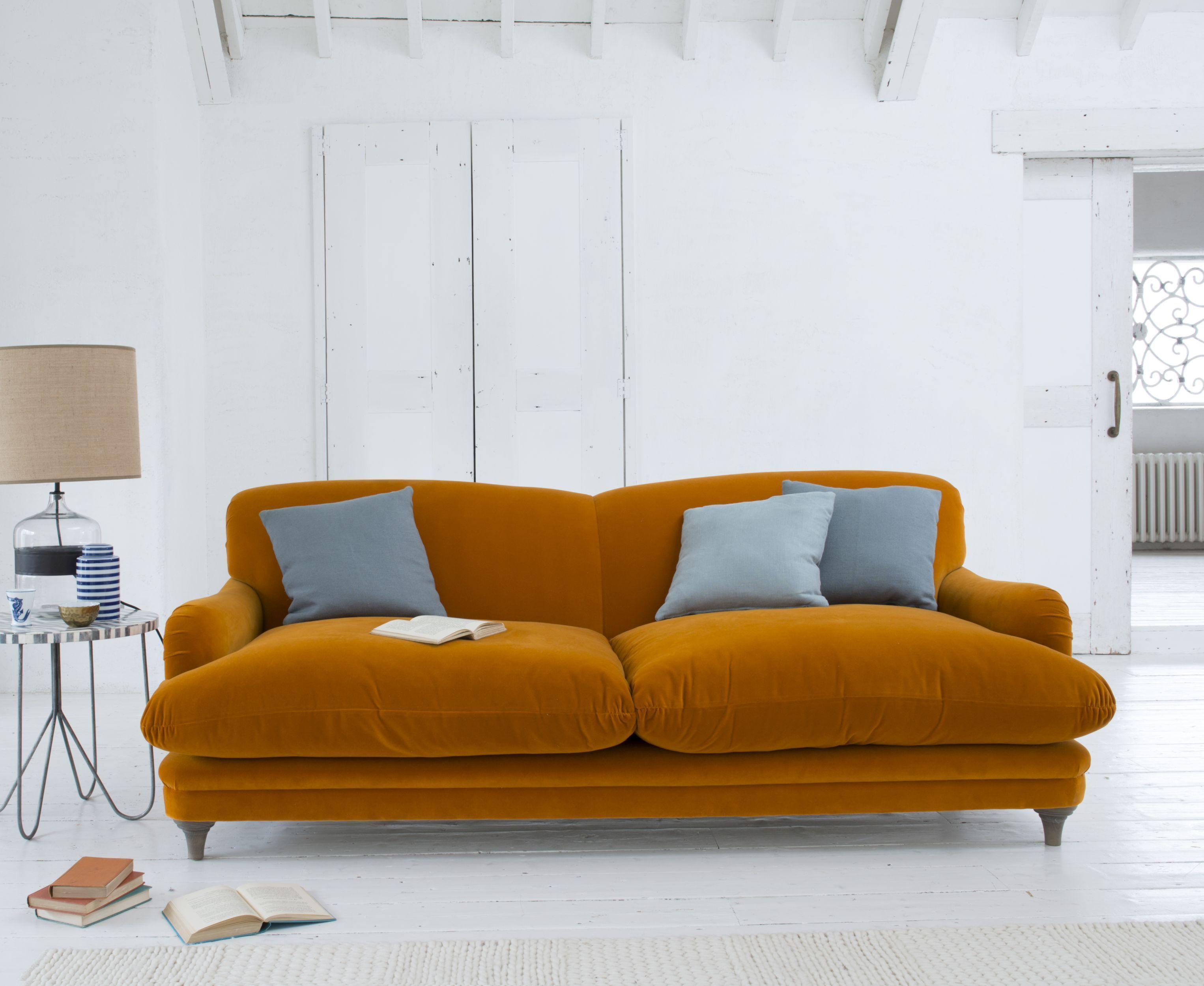 Pudding sofa, in burnt orange plush velvet, from £1,195, Loaf