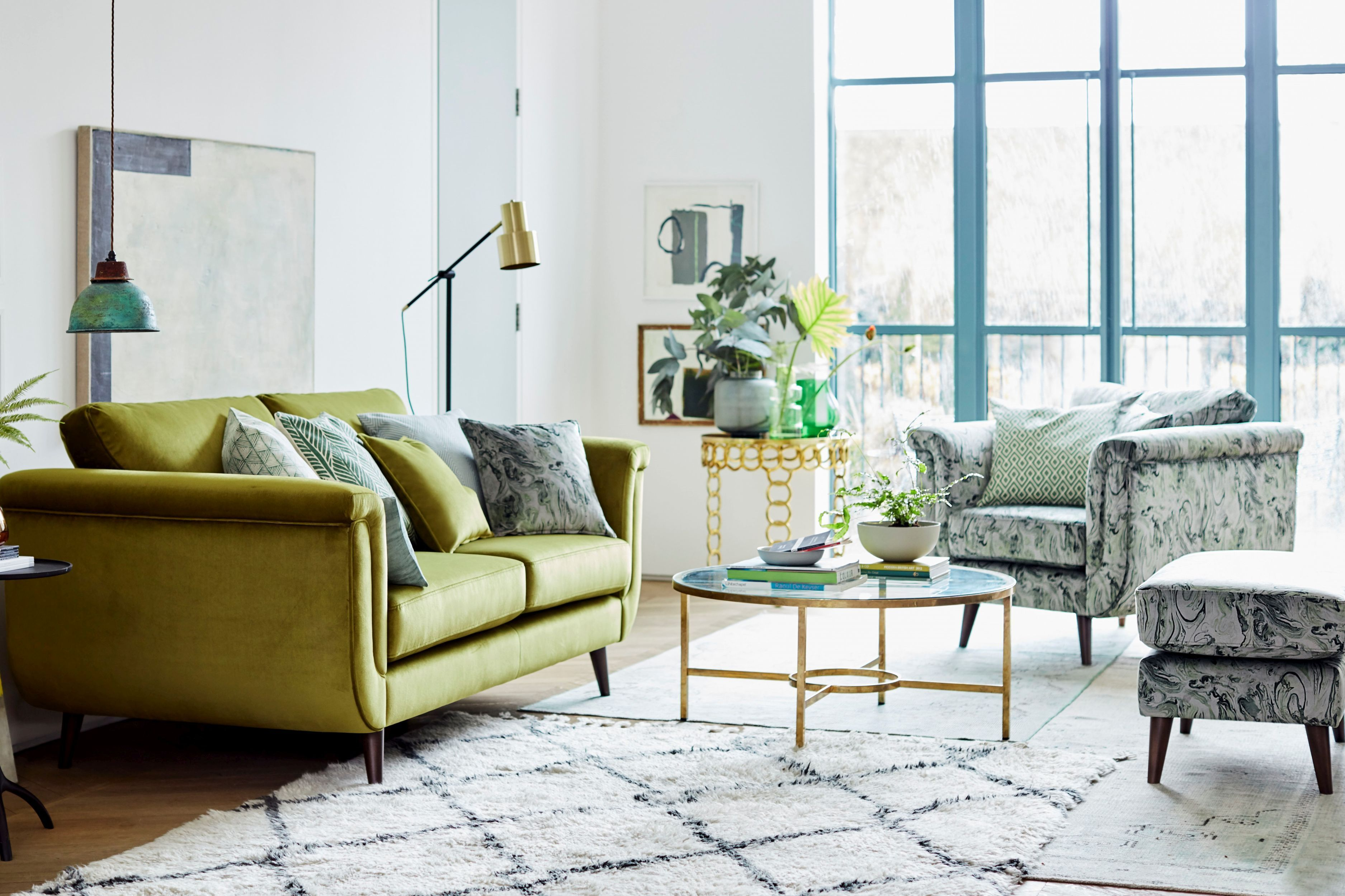 Topaz sofa, £1,598 and pattern standard chair, £1,098 and pattern rectangular footstool, £698, DFS